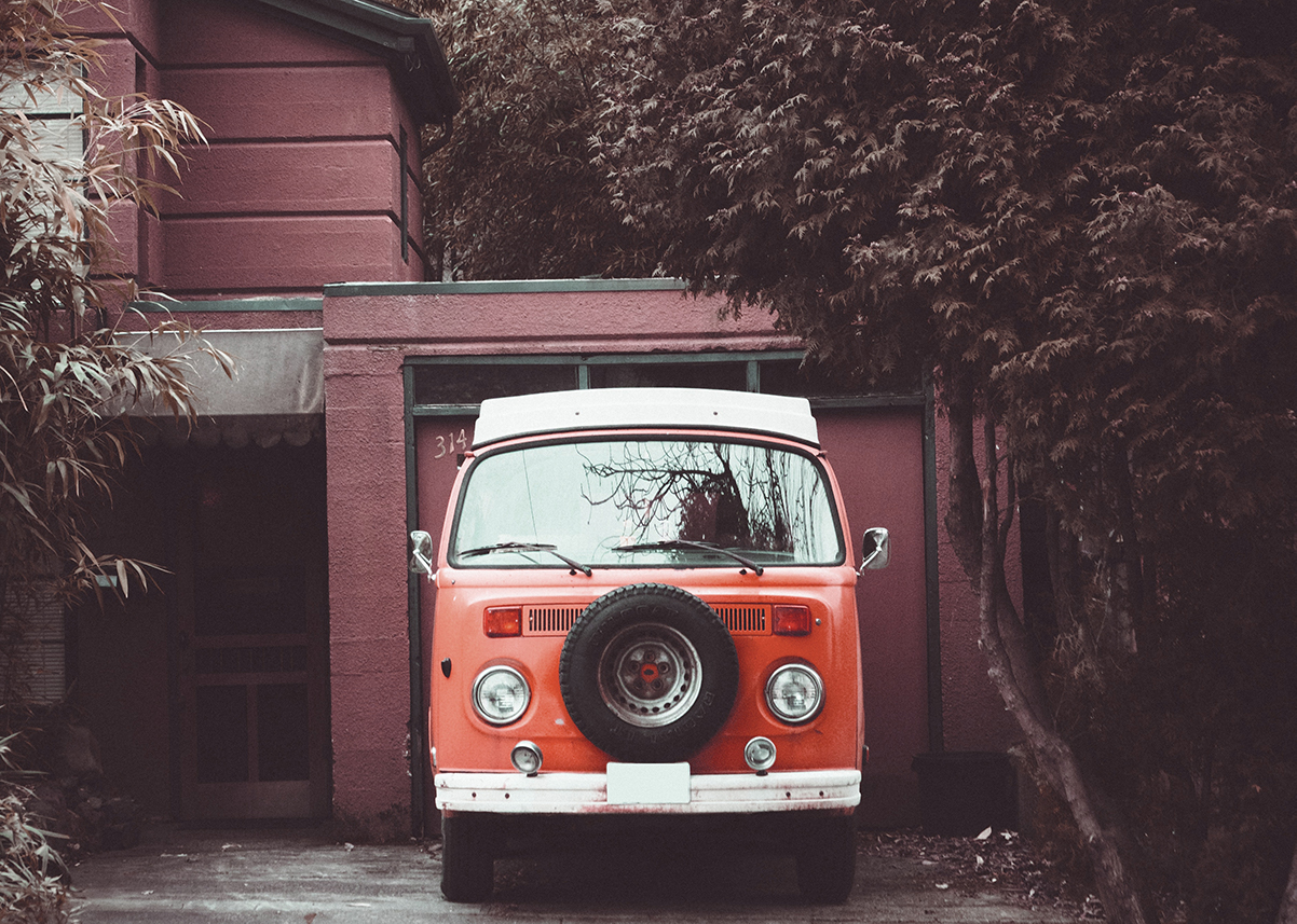 Campervan parked in fornt of a home